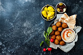istock Middle Eastern traditional dinner. Authentic arab cuisine. Meze party food. Top view, flat lay, overhead 1125048666