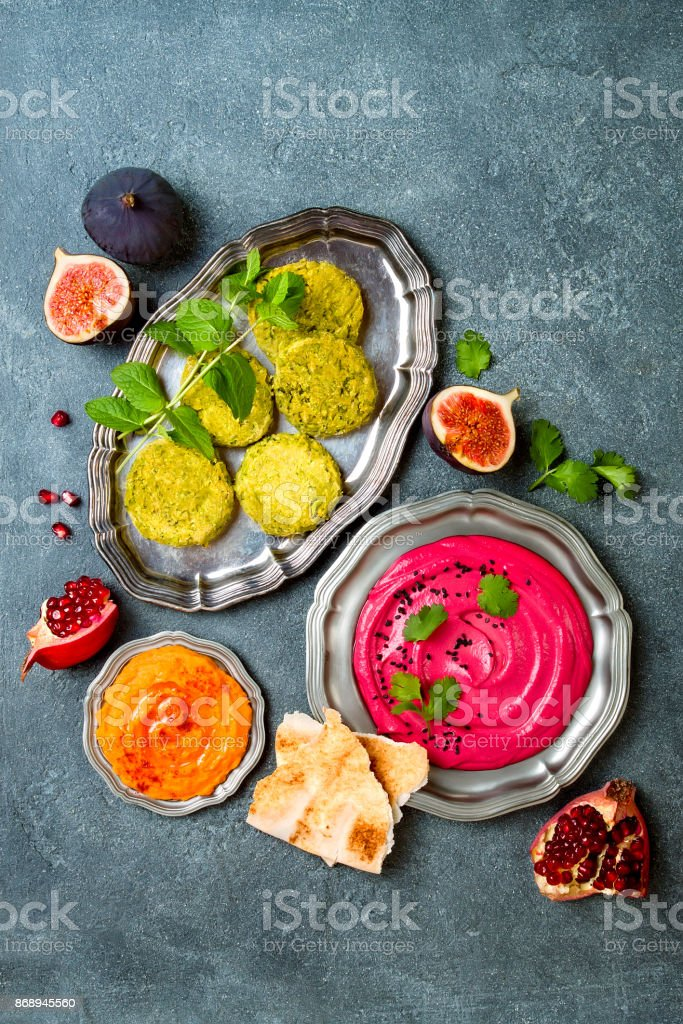 Middle Eastern traditional dinner. Authentic arab cuisine. Meze party food. Top view, flat lay, overhead stock photo