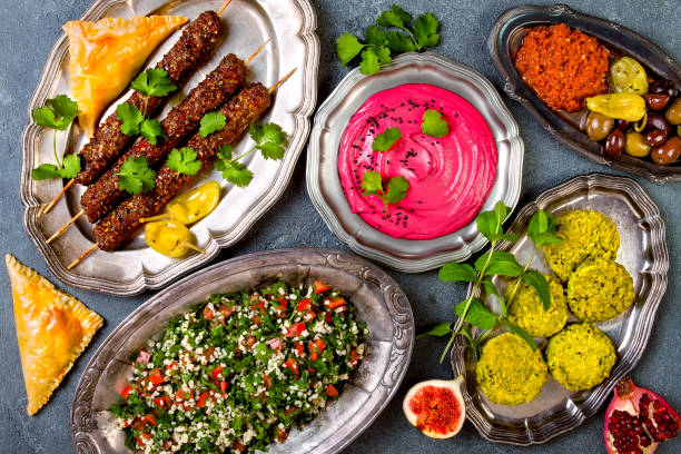 Middle Eastern traditional dinner. Authentic arab cuisine. Meze party food. Top view, flat lay, overhead Middle Eastern traditional dinner. Authentic arab cuisine. Meze party food. Top view, flat lay, overhead arabia stock pictures, royalty-free photos & images