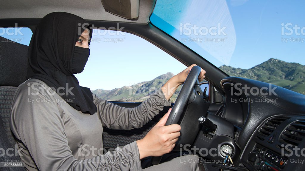 Middle Eastern Woman Drives Car MS stock photo