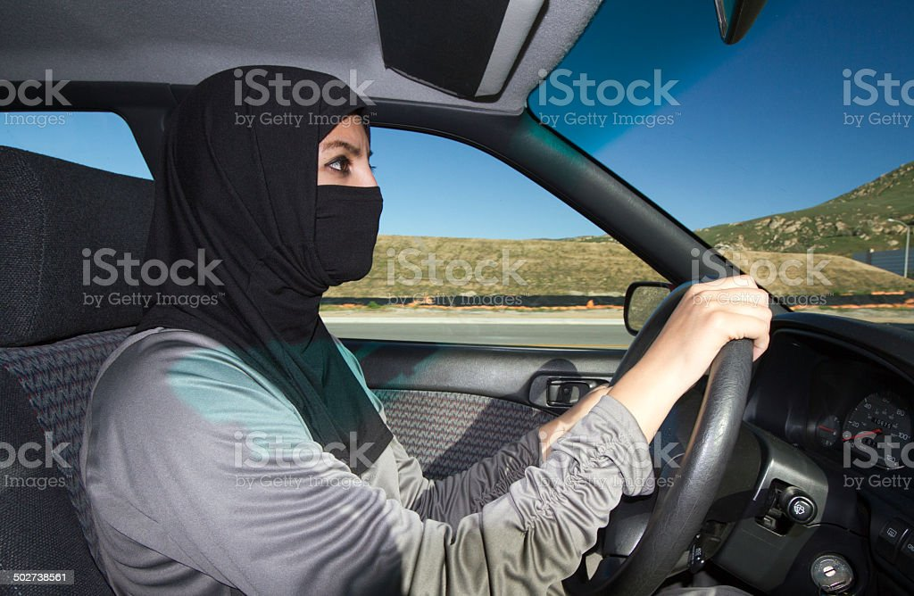Middle Eastern Woman Drives Car stock photo