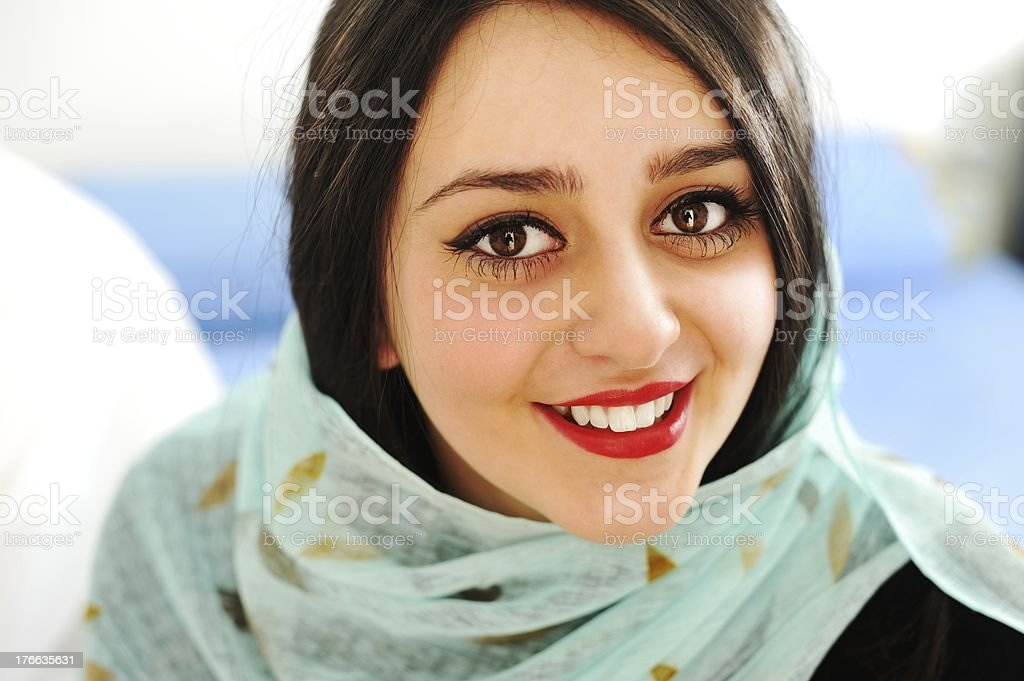 Middle eastern woman in portrait with a scarf on stock photo