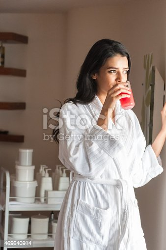 istock Middle Eastern Woman in Spa Treatment Room Drinking Juice 469640914