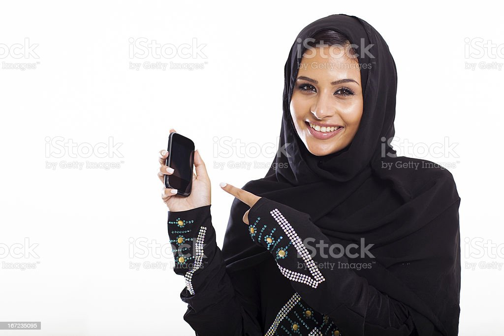 middle eastern woman pointing at smart phone royalty-free stock photo