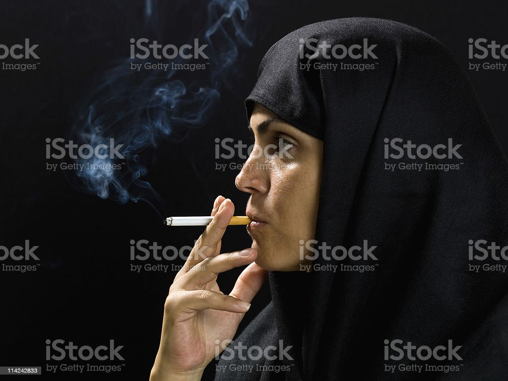 Middle Eastern Woman Smoking a Cigarette royalty-free stock photo