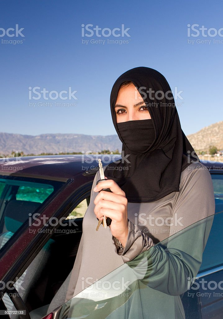 Middle Eastern Woman With Car Key Outside stock photo