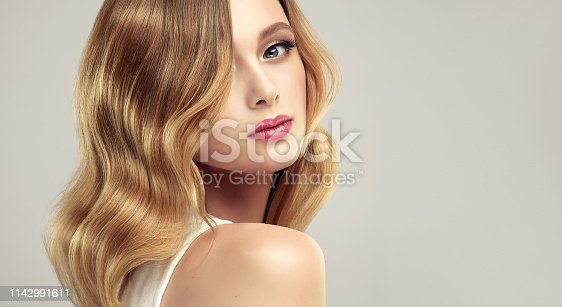 Hair color of straw, middle length hairstyle, soft, almost inviseble makeup. Close up beauty portrait of young, gorgeous woman.Cosmetic, cosmetology, hairdressing and makeup.