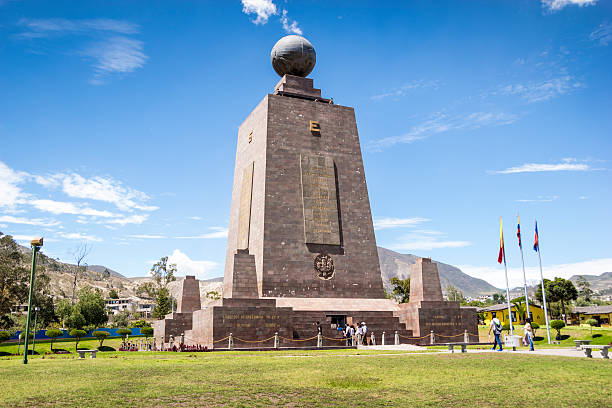 Middle of the World monument in Ecuador Quito, Ecuador - December 10, 2016: A view of th Middle of the World monument in Ecuador. It's a sunny no clouds day. Many tourist are arriving at the monument and others taking pictures from outside. equator stock pictures, royalty-free photos & images