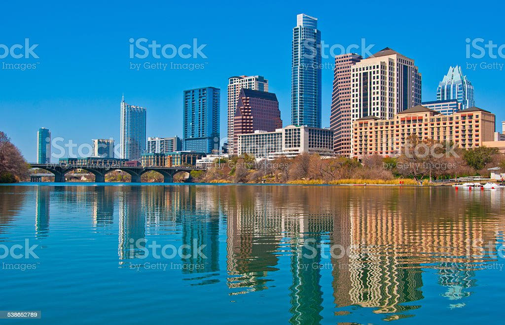 Middle of Town lake Austin Syline mirror reflections blue sky stock photo
