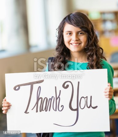 istock Middle school age girl holding