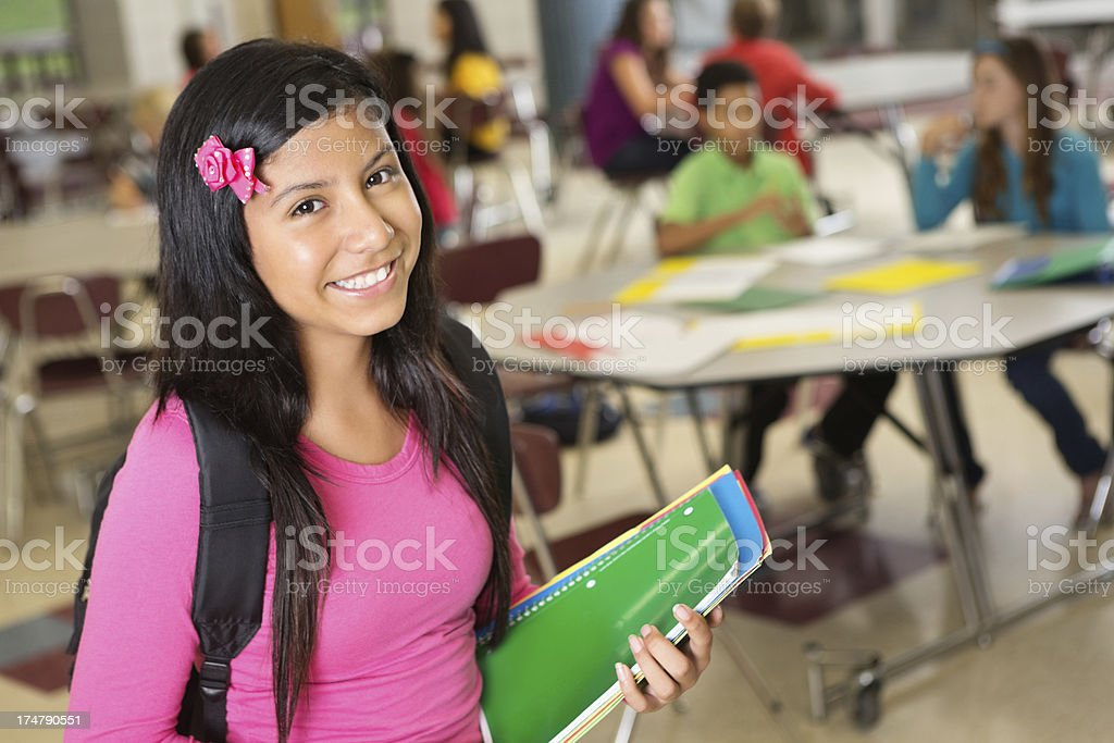 Middle school girl with books wating for class to begin royalty-free stock photo