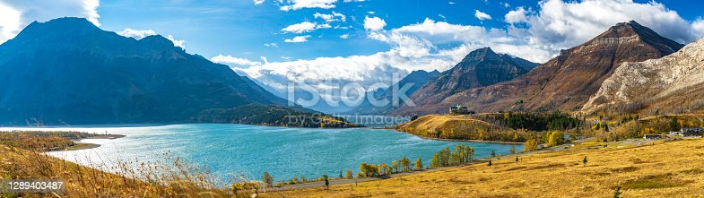 istock Middle Waterton Lake lakeshore in autumn foliage season sunny day morning. 1289403487