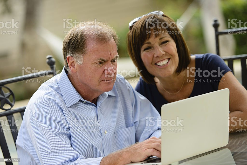 MIddle-Age Couple Learning To Use Technology royalty-free stock photo