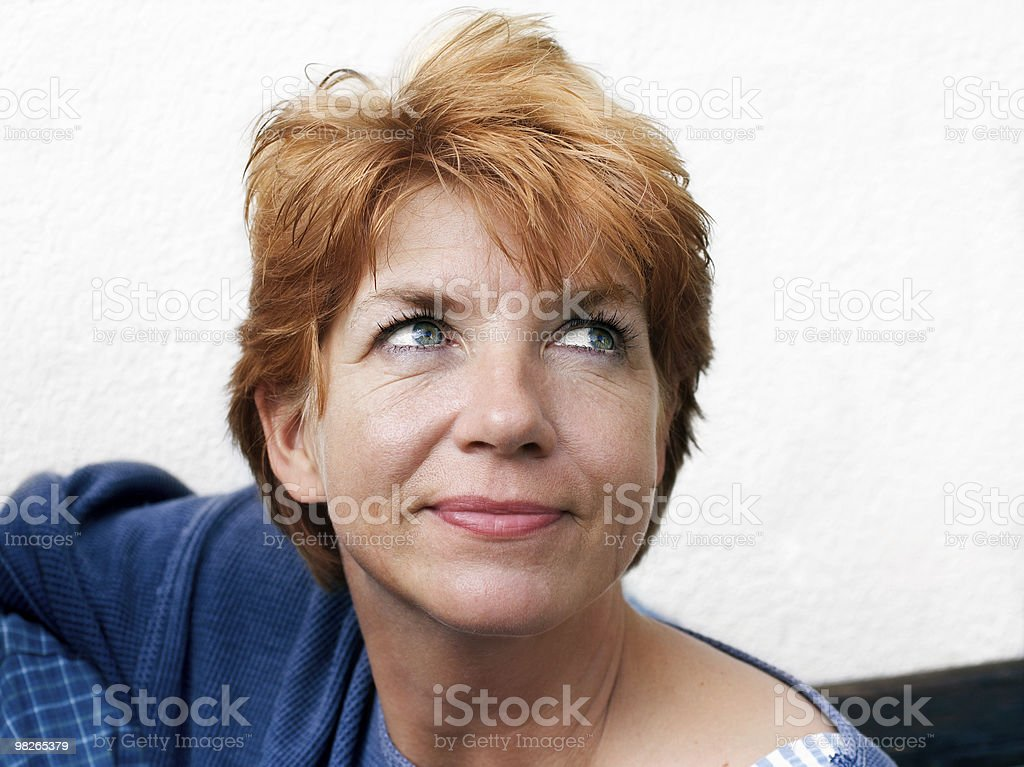 Middle-age  woman looking up royalty-free stock photo