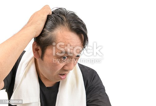 Middle-aged asian man worry about his  hair loss or alopecia and grey hair isolated on white background, Health care concept