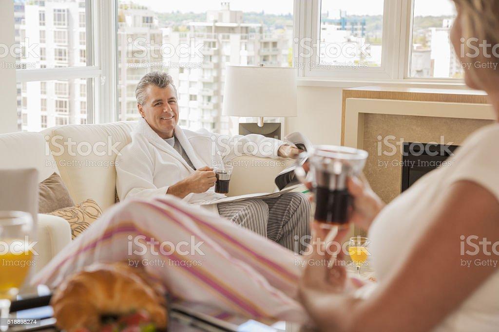 Middle-aged couple enjoying a leisurely morning stock photo