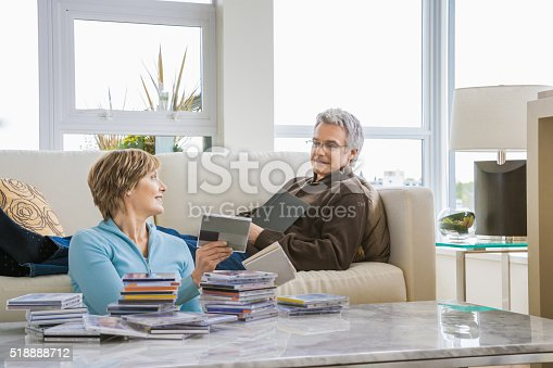 Middle-aged couple relaxing in living room