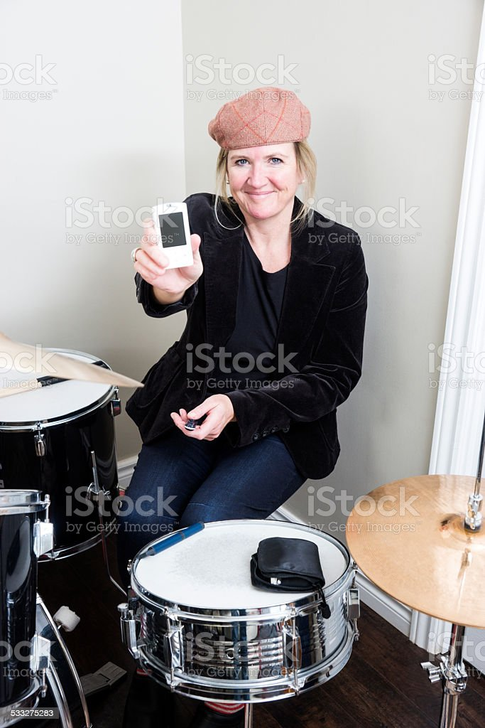 Middle-aged diabetic woman keeping her diabetes in check stock photo