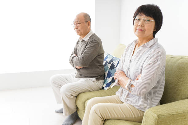 middle-aged divorce image middle-aged divorce image asian couple arguing stock pictures, royalty-free photos & images