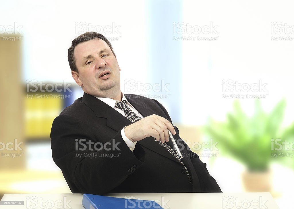 Middle-aged interviewer showing off stock photo