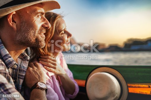istock Middle-aged man and his companion handsome blond lady on a boat ride in Bangkok 647427484