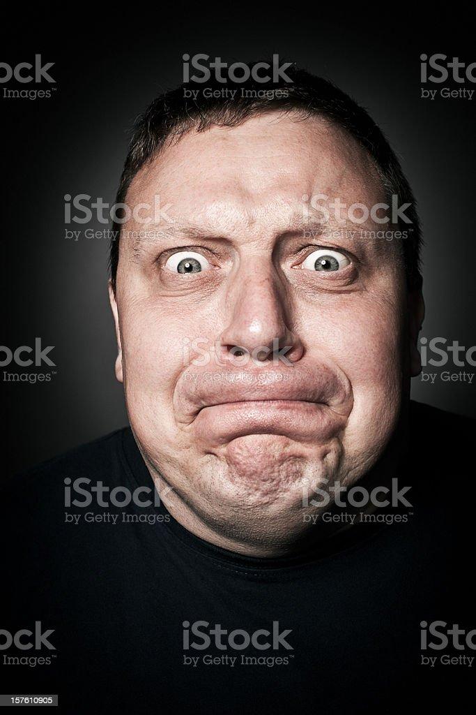 Middle-Aged Man Holding Back Anger, Studio Portrait royalty-free stock photo