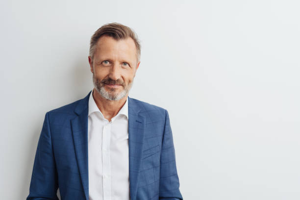 Middle-aged man in blue blazer, copy space stock photo