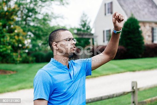 598157464 istock photo Middle-aged man signaling 803131380