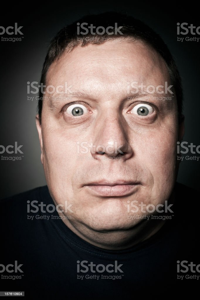 Middle-Aged Man Staring Intently, Studio Portrait royalty-free stock photo