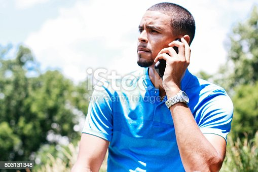 istock Middle-aged man talking on a cellphone 803131348