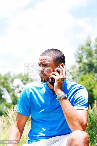 istock Middle-aged man talking on a cellphone 803131350