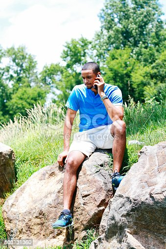 istock Middle-aged man talking on a cellphone 803131360