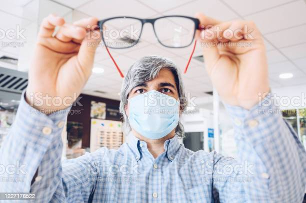 Middleaged man wearing flu mask holding modern glasses in his hands picture id1227176522?b=1&k=6&m=1227176522&s=612x612&h=kpkc6l1hieln8r2 c1ykacp4cyxo2ggo6bfec9afq9y=