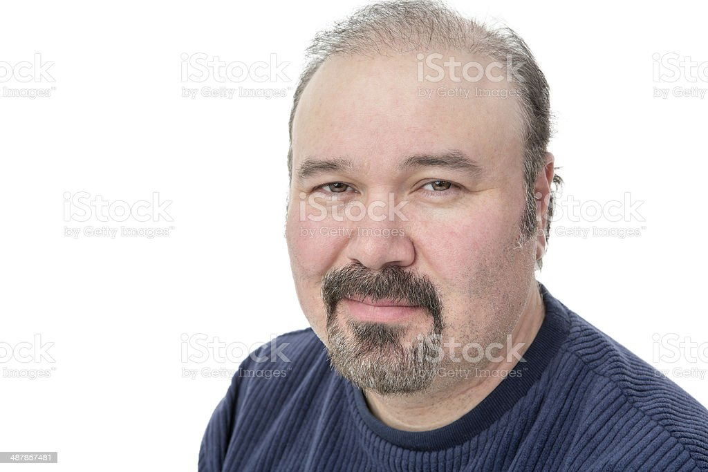 Middle-aged man with a speculative look stock photo