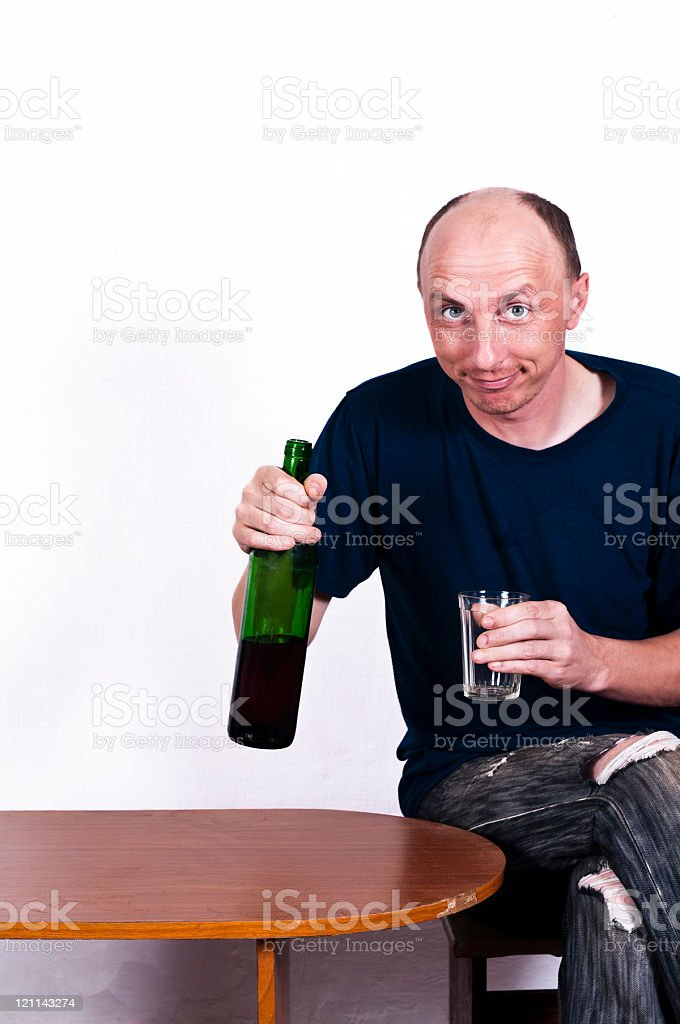 Middle-aged man with bottle and a glass royalty-free stock photo