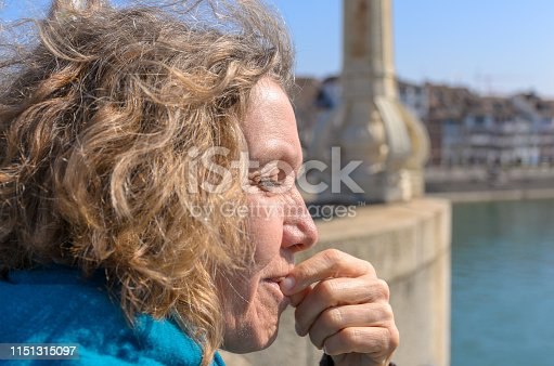 istock Middle-aged woman enjoying the spring sunshine 1151315097