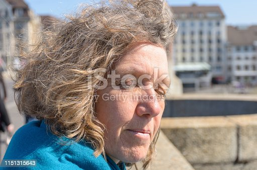 istock Middle-aged woman enjoying the spring sunshine 1151315643