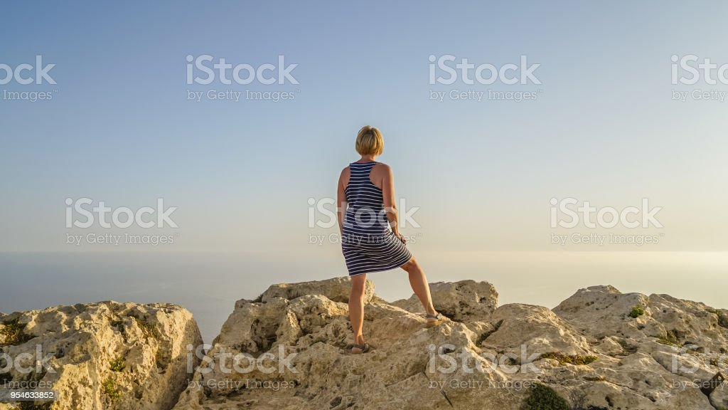 Middle-aged woman looks into distance stock photo