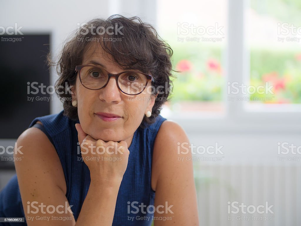 middle-aged woman with glasses stock photo