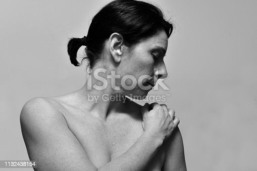 middle-aged woman with shoulder pain