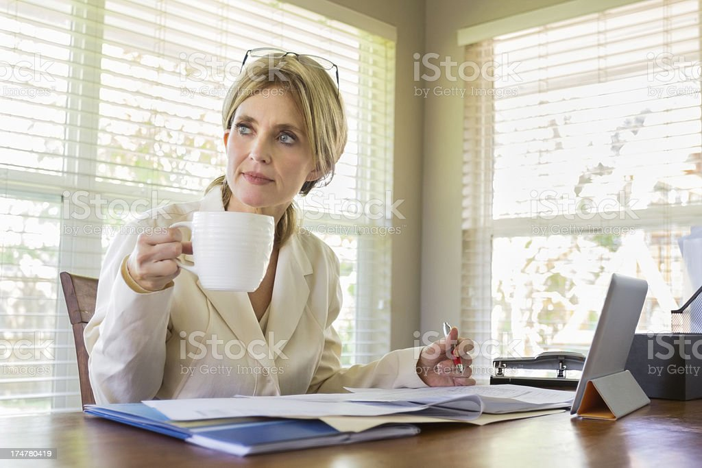 Middle-aged woman working in her office royalty-free stock photo
