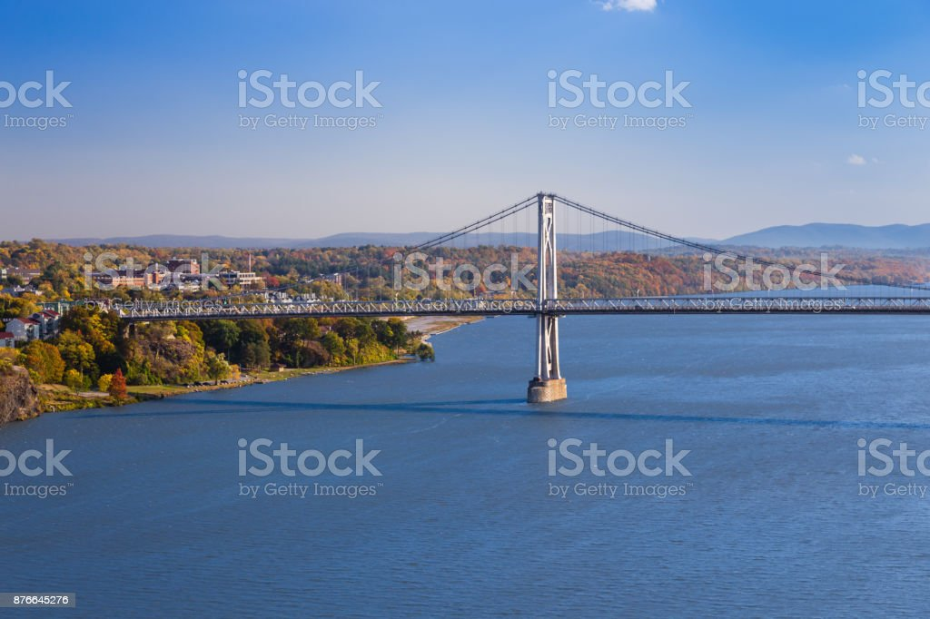 Mid-Hudson Bridge and Hudson River with Trees in Autumn Colors (Foliage) and Blue Sky, Poughkeepsie, Hudson Valley, New York. stock photo