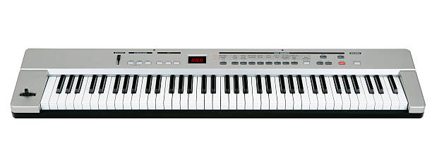 Midi keyboard on white Digital midi keyboard (6.5 octaves) isolated on white. synthesizer stock pictures, royalty-free photos & images