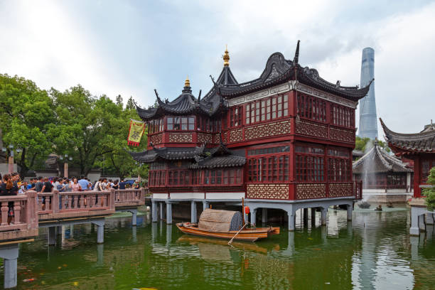 Mid-lake Pavilion Teahouse in Shanghai Shanghai, China - August 10 2018: The Huxinting Tea House (also known as Mid-lake Pavilion Teahouse) in the old town with behind, the Shanghai Tower. tea room stock pictures, royalty-free photos & images