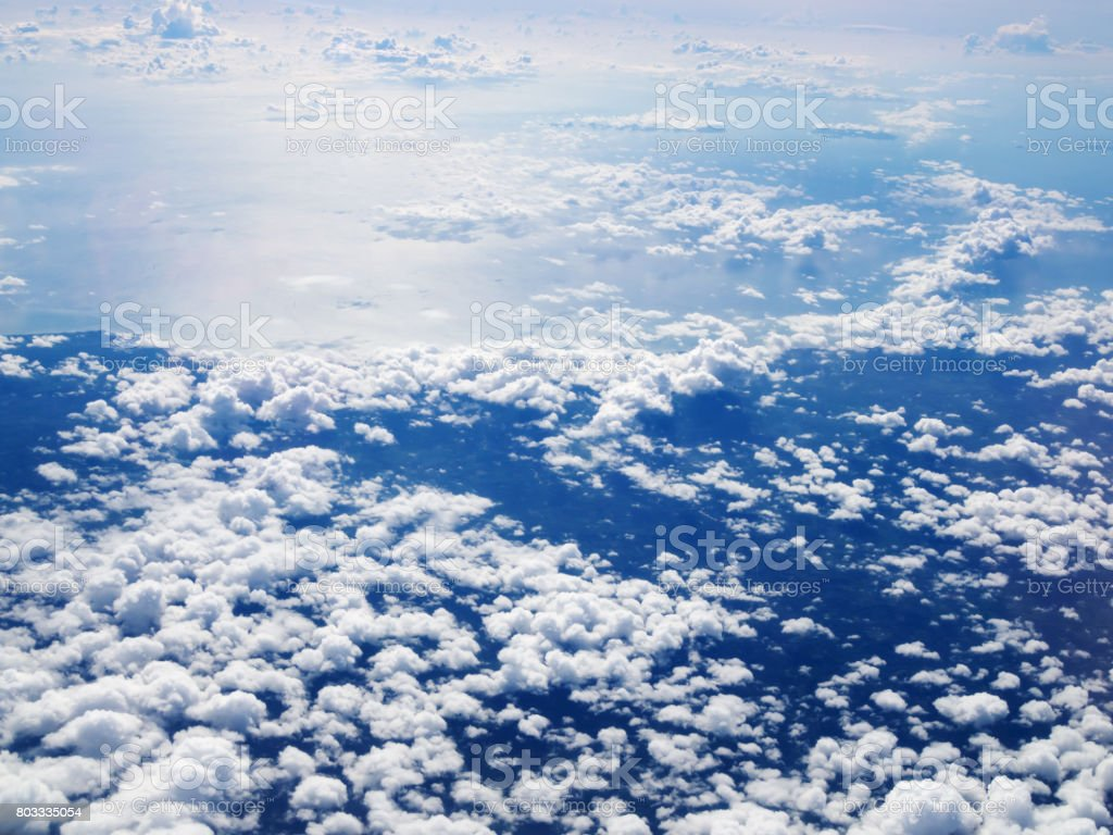 Mid-level cloudscape altocumulus white clouds. Altocumulus middle-altitude cloud in stratocumuliform. View from airplane white flying over sky. stock photo