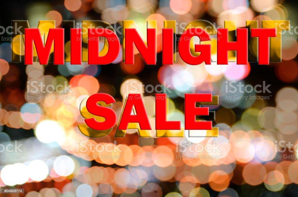 Midnight sale sign on bokeh light background. stock photo
