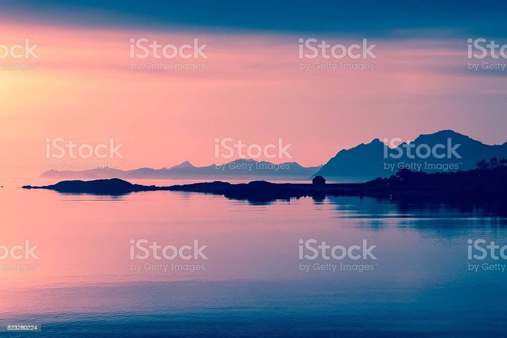 midnight sun at lofoten islands stock photo