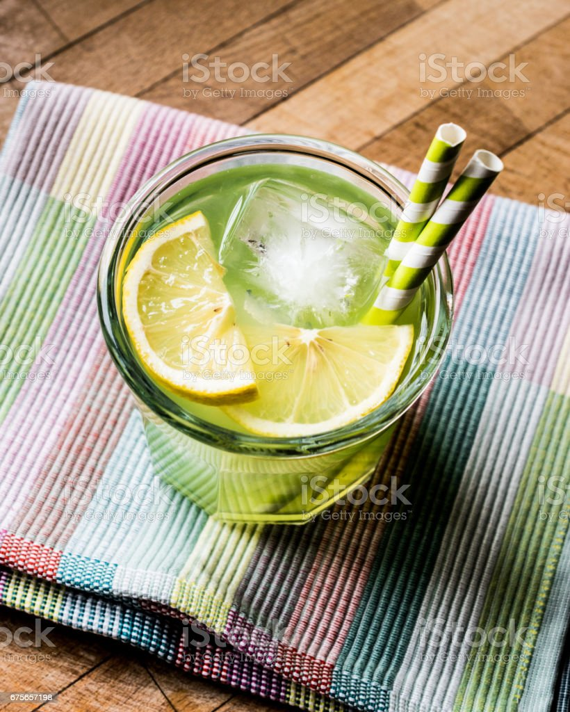 Midori Sour Cocktail with ice and lemon. royalty-free stock photo