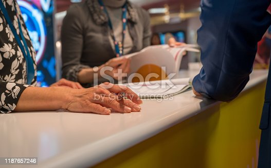 845085240istockphoto Midsection of business people at conference table 1187657246