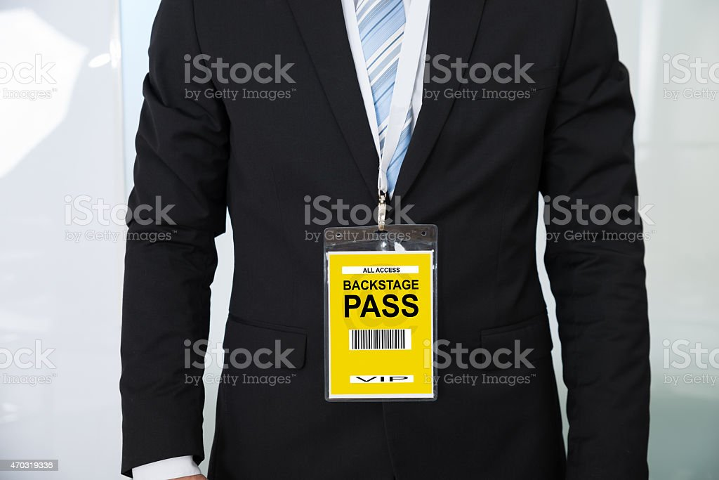 Midsection Of Businessman Wearing Backstage Pass stock photo